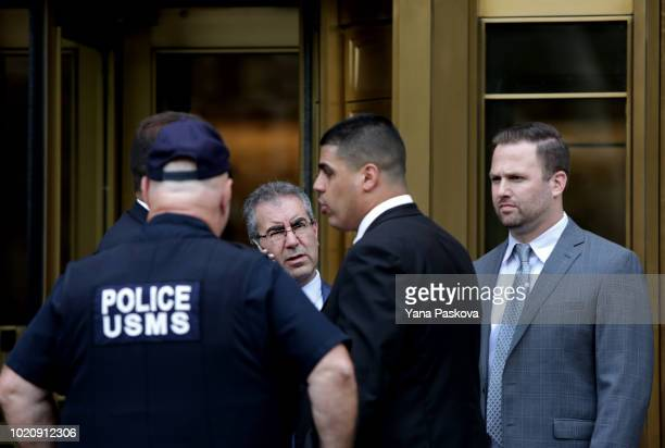 Police gather before Michael Cohen former lawyer to US President Donald Trump exits the Federal Courthouse on August 21 2018 in New York City Cohen...