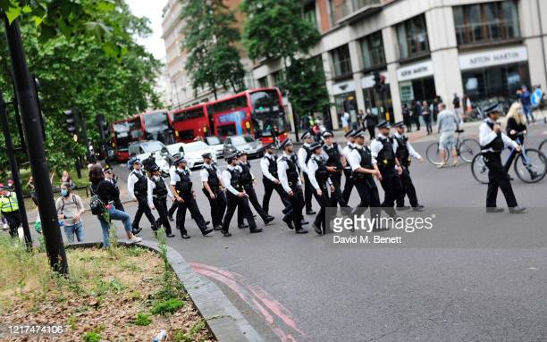 Police gather during a Black Lives Matter demonstration in Hyde Park on June 3, 2020 in London, England. The death of an African-American man, George...