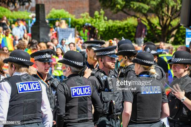police gather for exeter pride with rainbow face paint - istock photo stock pictures, royalty-free photos & images