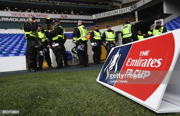Police gather inside the ground prior to The Emirates FA Cup QuarterFinal match between Tottenham Hotspur and Millwall at White Hart Lane on March 12...