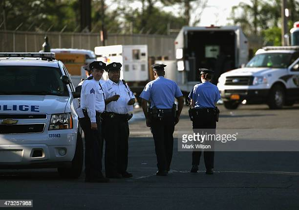 Police gather near the site of the Amtrak train derailment May 14 2015 in Philadelphia Pennsylvania Service has been interrupted after an Amtrak...