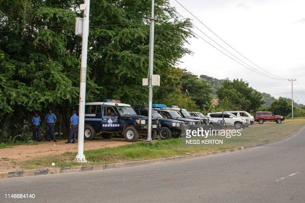 Police gather on a closed road leading to Parliament house in Port Moresby on May 28 2019 Papua New Guinea Prime Minister Peter O'Neill stalled his...
