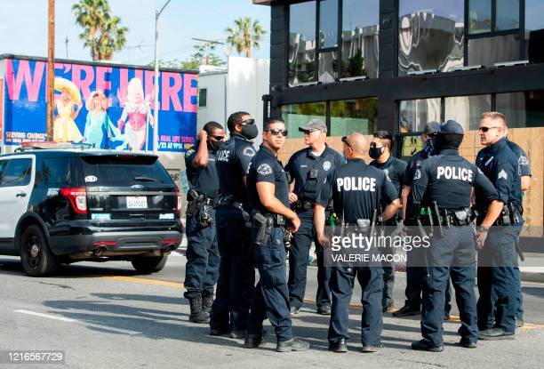 Police gather on Melrose Avenue on May 31, 2020 in Los Angeles, California. - Clashes broke out and major cities imposed curfews as America began...