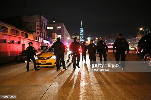 Police gather on the West Side Highway during a protest December 4 2014 in New York Protests began after a Grand Jury decided to not indict officer...