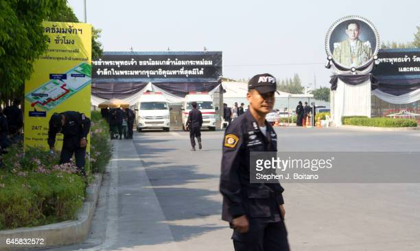 Police gather outside the entrance to Wat Phra Dhammakaya in Pathum Thani province, on the outskirts of Bangkok, Thailand. Thai authorities plan to...
