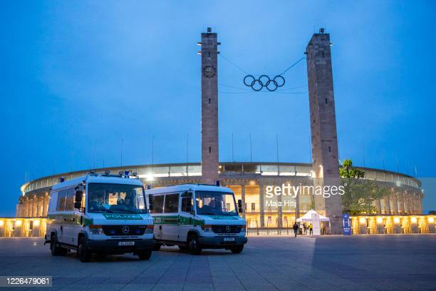 Police gather outside the Olympiastadion during to the Bundesliga match between Hertha Berlin and Union Berlin during the coronavirus crisis on May...