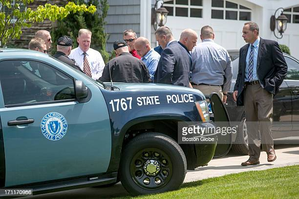 Police gathered at the home of New England Patriots player Aaron Hernandez in North Attleborough. Hernandez has been linked to the ongoing murder...