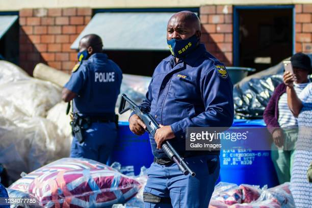 Police go door to door to confiscate suspected looted goods at Mansel Market in the Central Business District on July 19, 2021 in Durban, South...
