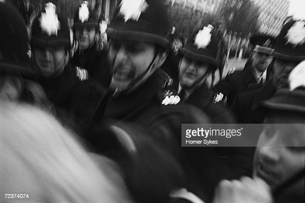 Police grab at a demonstrator during an AntiVietnam War demonstration outside the US embassy in Grosvenor Square London 1968