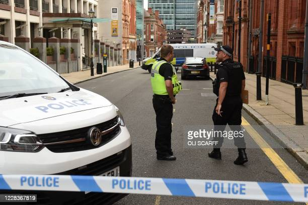 Police guard a cordon on Edmund Street following a major stabbing incident in the centre of Birmingham, central England, on September 6, 2020. -...