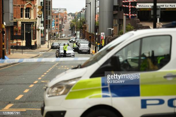 Police guard a cordon on Livery Street following a major stabbing incident in the centre of Birmingham, central England, on September 6, 2020. -...