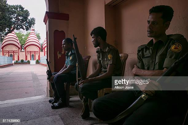 Police guard a Hindu temple on March 20 2016 in Dhaka Bangladesh Amid the attacks in Brussels on Tuesday ISIS also claimed responsibility for...