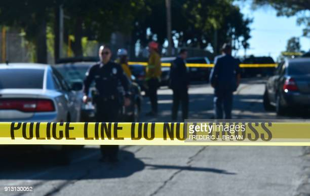 Police guard a roadblock near Salvadore Castro Middle School in Los Angeles California on February 1 where two students were wounded one critically...