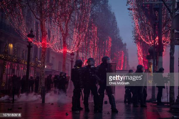 Police guard a side street during the 'yellow vests' demonstration on the ChampsElysées near the Arc de Triomphe on December 8 2018 in Paris France...