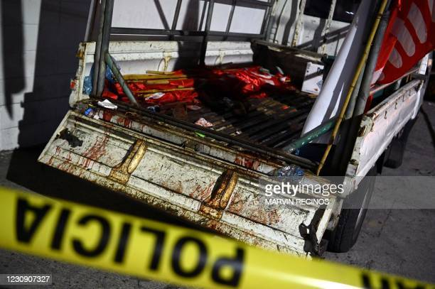 Police guard a truck that carried supporters of the political party Farabundo Marti Front , earlier attacked with firearms while returning from...