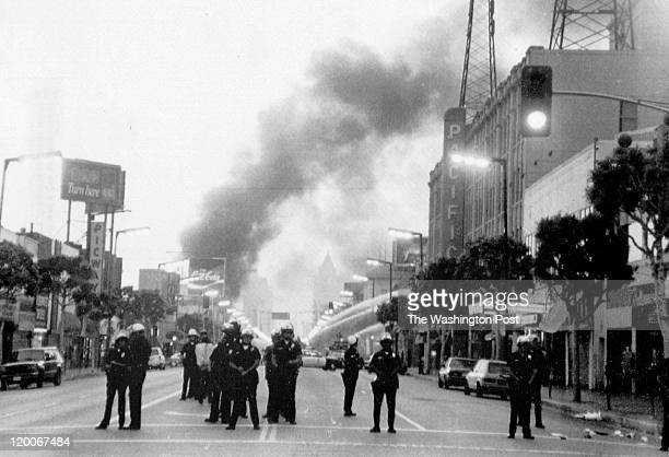 Police guard Hollywood Boulevard after the Rodney King incident sparked riots Photographed May 1 1992 in Los Angeles CA