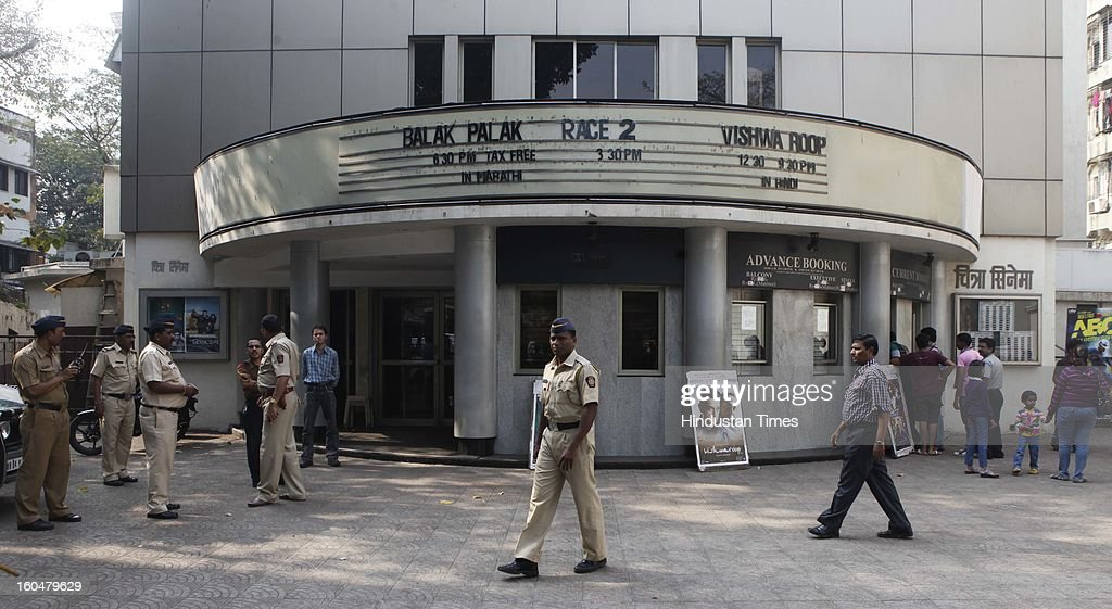 Police guard outside a Bandra Theatre where Kamal Haasan's film 'Vishwaroopam' was released at Dadar on February 1, 2013 in Mumbai, India. ,Vishwaroopam' is banned in Tamil Nadu with some Muslim groups taking objection to certain scenes in the movie as hurting their religious sentiments.