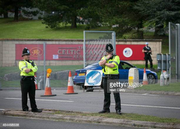Police guard outside the main gates at the Celtic Manor Resort ahead of the Nato Summit 2014 that is being held in South Wales next week on September...