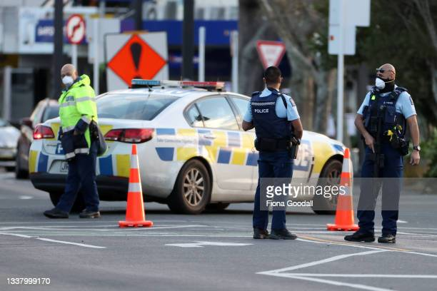 Police guard the area around Countdown LynnMall where a violent extremist reportedly stabbed six people before being shot by police on September 03,...