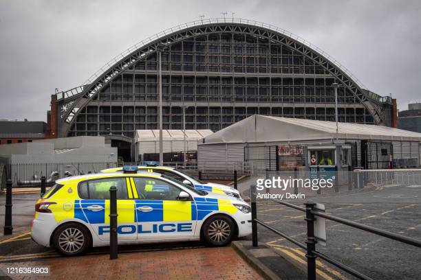 Police guard the back entrance to Manchester Central which is being turned into a Nightingale Hospital on April 02 2020 in Manchester United Kingdom...