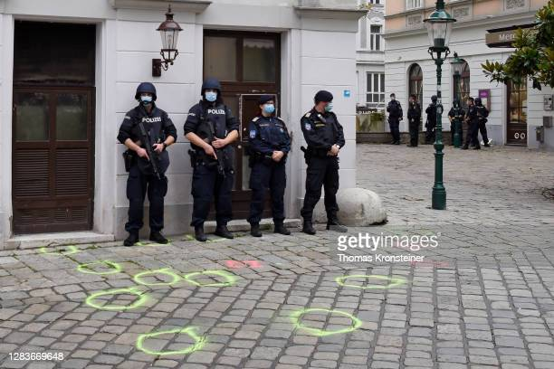 Police guard the crime scene after a wreath laying ceremony by the Austrian government in the city center the day after a deadly shooting spree on...