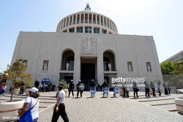 Police guard the Don Bosco Church to avoid occupation by demonstrators on August 10 2017 in Rome Italy Police evacuate dozens of families from an...