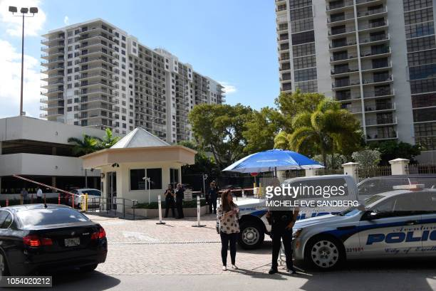 Police guard the entrance to the Clipper Apartment Building at Biscayne Cove Florida on October 26 2018 The building reportedly has been identified...