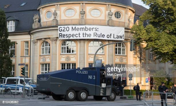 Police guard the entrance to the venue for the G20 summit on July 7 2017 in Hamburg Germany Leaders of the G20 group of nations are meeting for the...