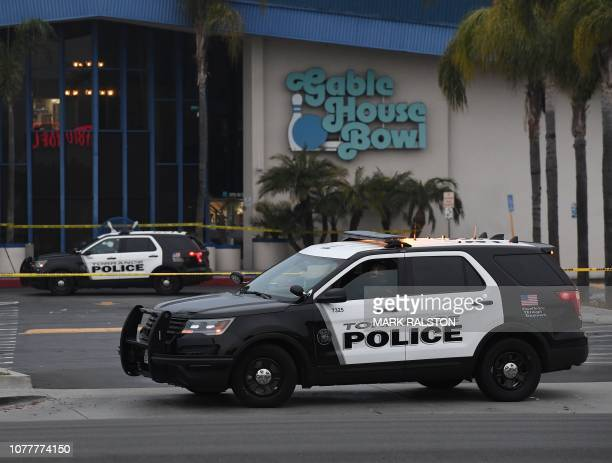 Police guard the Gable House Bowl center after 3 men were killed and 4 injured in a shooting at the bowling alley in Torrance California according to...