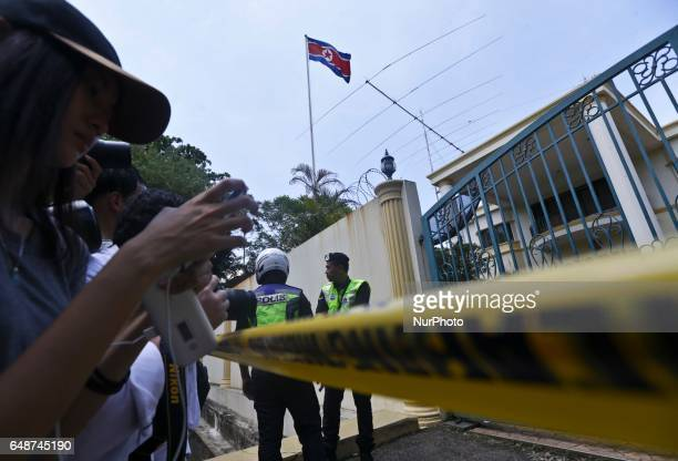 Police guard the gate of the Embassy after cordoning of the gate to deter media from obstructing vecihles coming in and out before the North Korean...