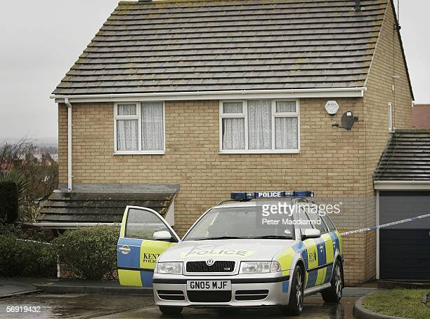 Police guard the house of the Securitas depot manager on February 23 2006 in Herne Bay England Police have announced that Britain's biggest cash...