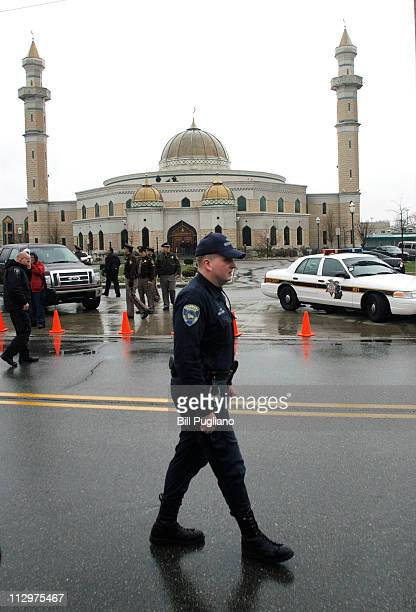 Police guard the Islamic Center of America prior to a planned protest there by Pastor Terry Jones of the Dove World Outreach Center in Gainesville...