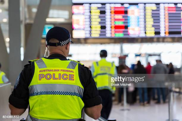 Police guard the passenger security check area at Sydney Airport on July 30 2017 in Sydney Australia Counter terrorism police raided four houses...