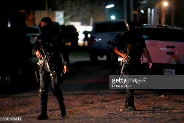 Police guard the place where 11 people were executed after an armed attack in the community of Tonala, state of Jalisco, Mexico, on February 27, 2021.