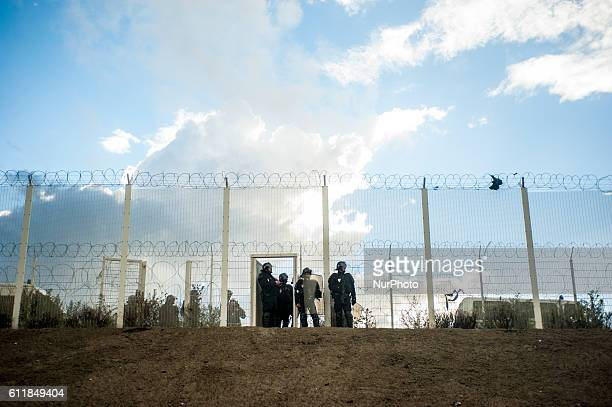 Police guard the port ring road which is separated from the jungle by fences in Calais France October 1st 2016 A prorefugee demonstration was banned...