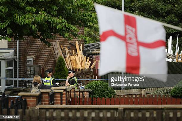Police guard the scene at the suspect's home after Jo Cox Labour MP for Batley and Spen, was killed by an attacker at her constituicency on June 16,...