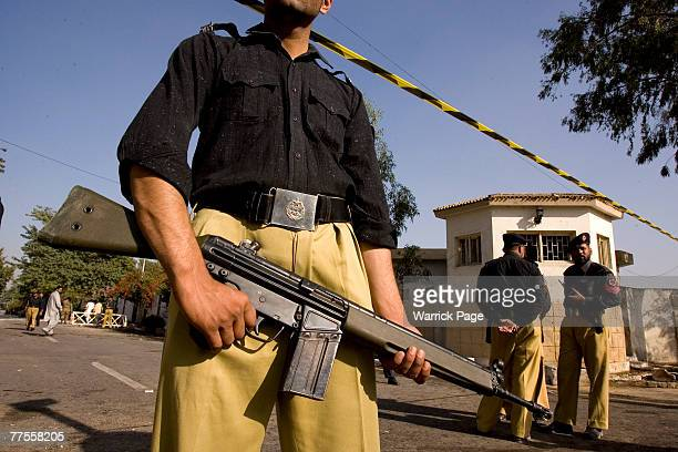 Police guard the site of a suicide bombing at an army checkpoint, October 30, Rawalpindi, Pakistan. At least six people were killed and 11 injured in...