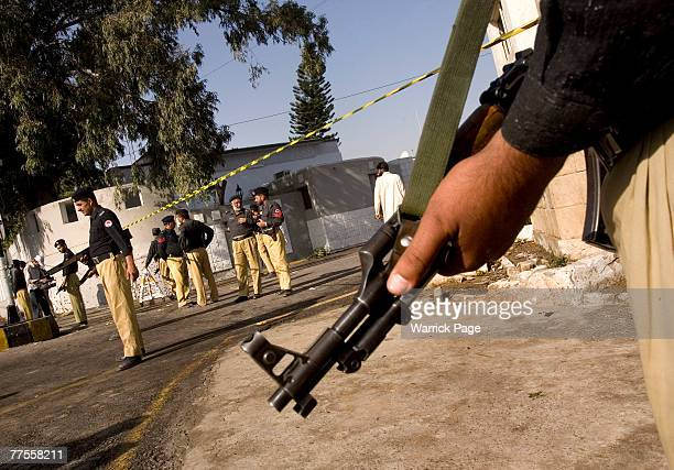 Police guard the site of a suicide bombing at an army checkpoint October 30 Rawalpindi Pakistan At least six people were killed and 11 injured in the...