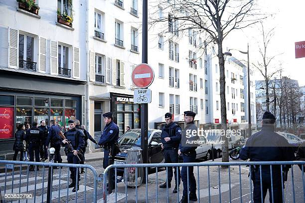 Police guard the streets near to the Police station where a man was shot dead on January 7 2016 in Paris France French Police have shot dead a man as...