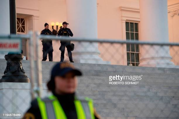 Police guard the Virginia State Capitol building in Richmond Virginia on January 20 2020 Thousands of gun rights supporters descended for a rally in...