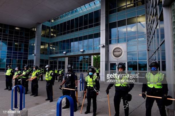 """Police guard their headquarters during the """"Unite Against Racist Police Terror! Boston Speakout and March"""" in Boston, Massachusetts on June 7, 2020...."""