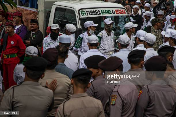 Police guarded the demonstration Hundreds of muslims from Indonesian Islam defender and some underbow muslim organization held demonstration in front...