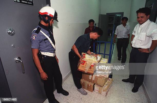 Police guarding a safe where seized drugs are stored before being brought to a drugburning ceremony