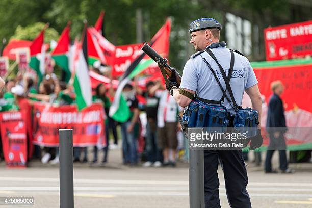Police guards as Palestinian activists protest in front of the Hallenstadium during the 65th FIFA Congress at Hallenstadion on May 29 2015 in Zurich...