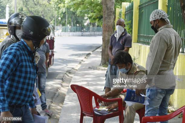 Police handing out a challan to traffic rule violators near Buddha Park on May 22, 2020 in Lucknow, India.