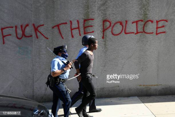 Police handle an arrested AfricanAmerican male as protesters clash with police near City Hall in Philadelphia PA on May 30 2020 Cities around the...