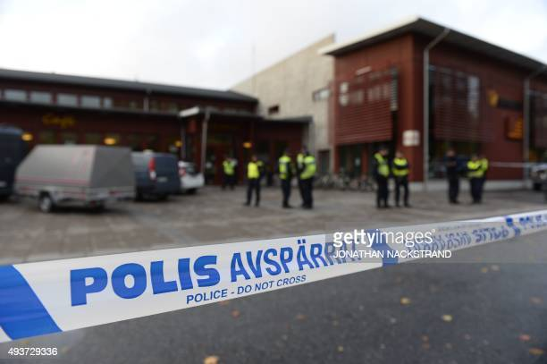 Police have cordoned off the scene at a primary and middle school in Trollhattan southwestern Sweden on October 22 where a masked man armed with a...