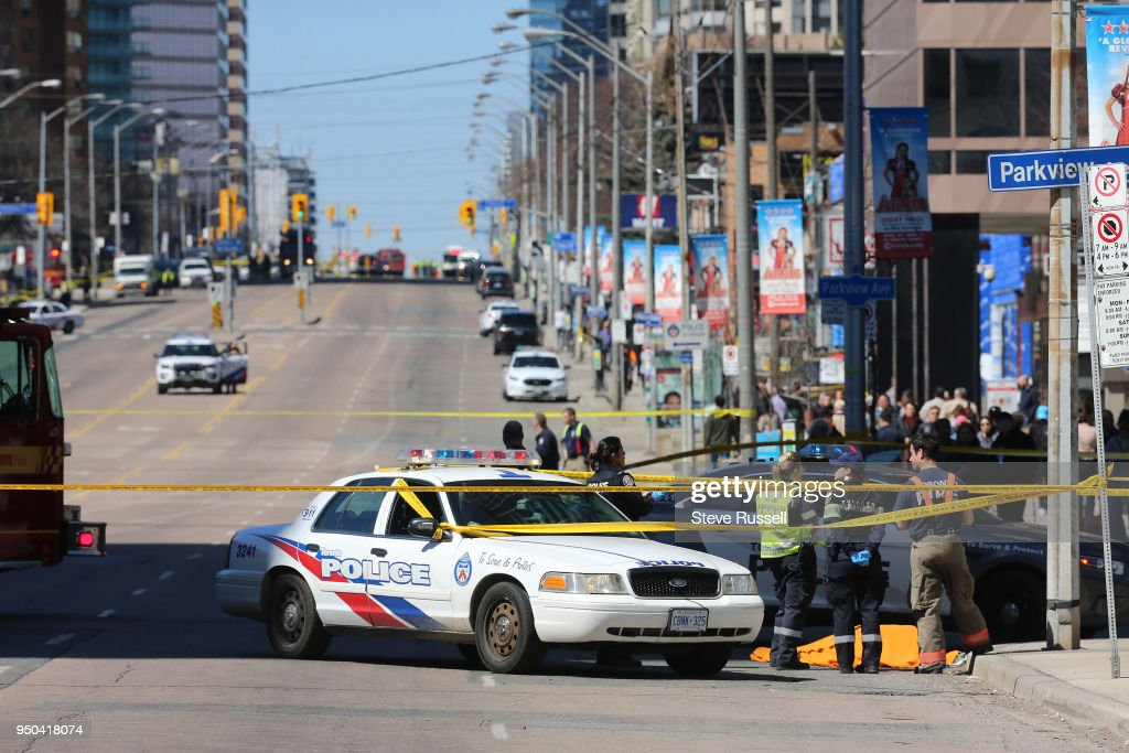 TORONTO, ON- APRIL 23 - Police have Yonge Street blocked off at Parkview Avenue where on of the victims lies on the East side of the street as the Police investigate a van that ran down pedestrians along Yonge Street between Sheppard and Finch streets in Toronto at the Air Canada Centre in Toronto. April 23, 2018.