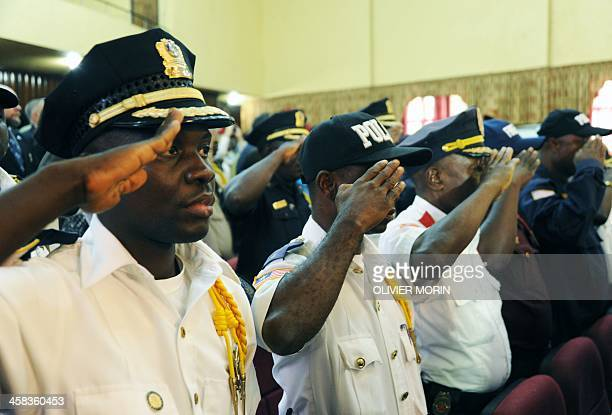 Police heads salute during a ceremony to mark the security handover from UN troops to Liberian forces on July 1 2016 in Monrovia Top Liberian and UN...