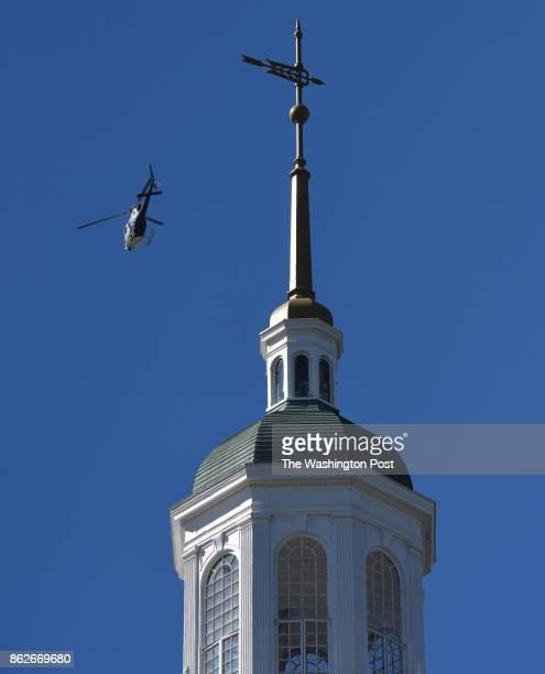 A police helicopter circles over the campus at Howard University after reports of an active shooter on campus October 17 2017 in Washington DC The...
